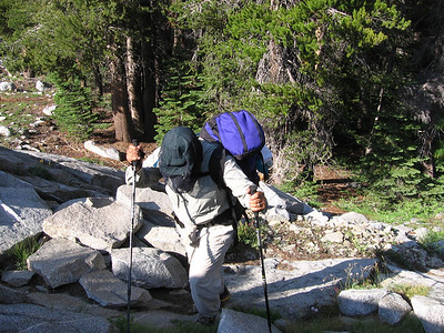 I had seen an area on the topo devoid of vegetation along our intended route; sure enough, a talus field. Sam's wearing his mosquito headnet, as the creek below harbored a fair number of pesky mosquitoes hungry for a meal of blood.