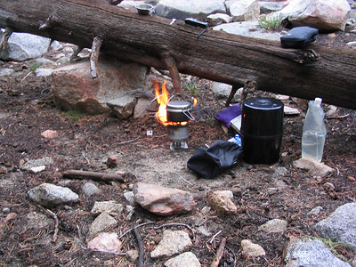 Cooking dinner on my wood-burning stove. Garcia bearcan and other devices can be seen.