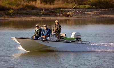 Three men in a small fishing boat.