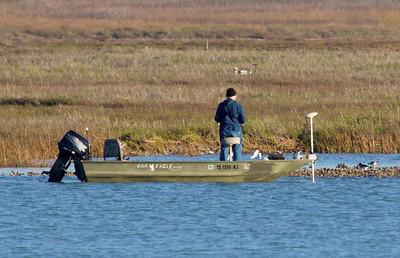 A distant marine biologist samples the Refuge water.