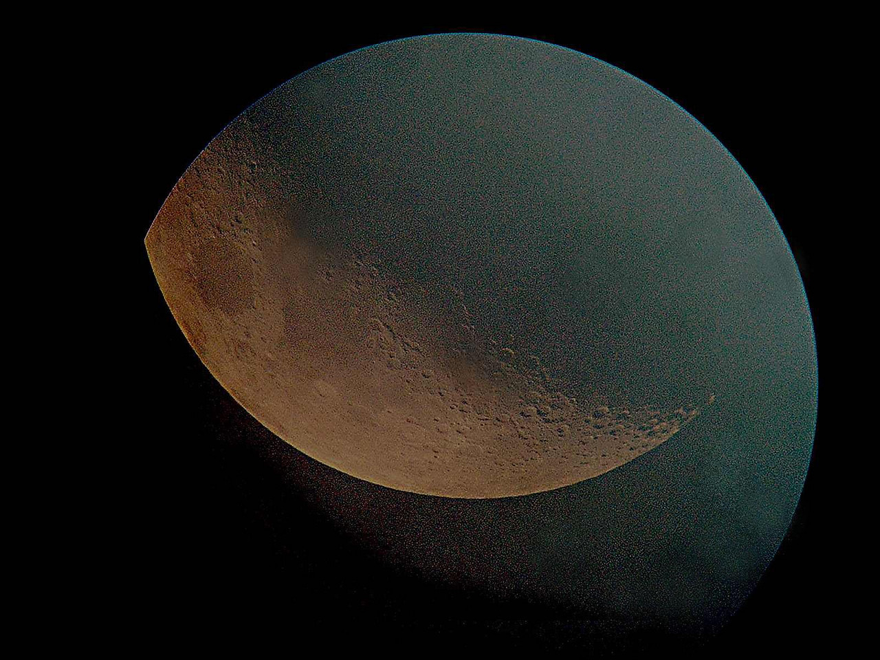 """Here's a bit of artistic work of the moon by Dan McKeel.  4""""f10 refractor HP digital, Photoshop Prime focus through clouds and a 12.5 mm eyepiece."""