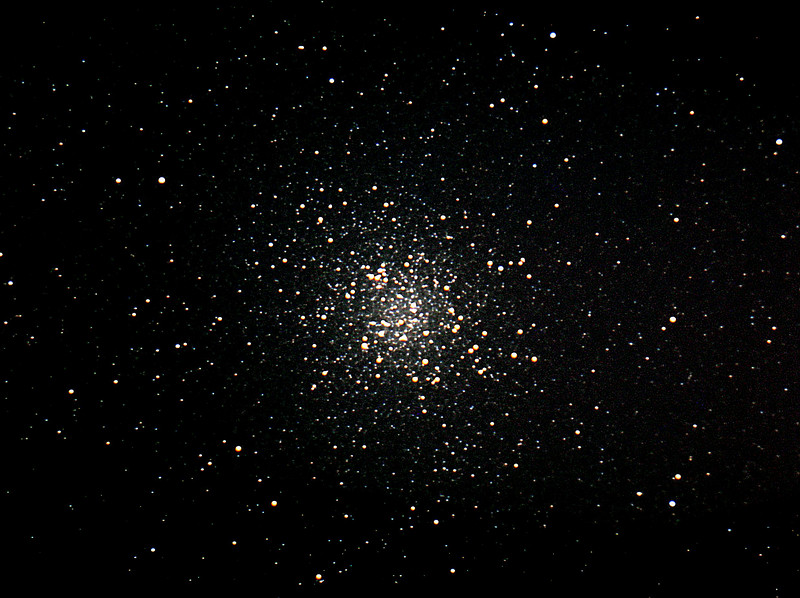 """Here's a great image by Dan McKeel of the great globular Cluster M-22, taken late August 2007.  All processing done in Images Plus 3.75  Camera used: Canon 300d   This is a composite of sixty five  20 second images for 21 minutes of total time  Telescope used: Meade 12"""" Lx200 @ F10 alt az.  All  seperate images stacked one over the next to obtain this final single image. Curves applied Lucy-Richardson sharpening Wavelet sharpening to small details High resolution TIF file is 22 megabytes"""