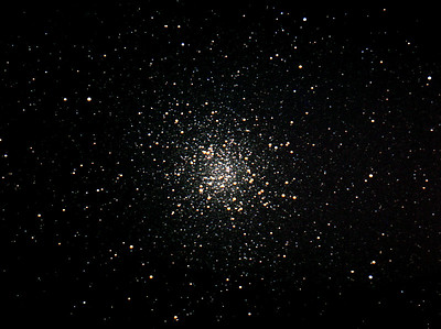 "Here's a great image by Dan McKeel of the great globular Cluster M-22, taken late August 2007.  All processing done in Images Plus 3.75  Camera used: Canon 300d   This is a composite of sixty five  20 second images for 21 minutes of total time  Telescope used: Meade 12"" Lx200 @ F10 alt az.  All  seperate images stacked one over the next to obtain this final single image. Curves applied Lucy-Richardson sharpening Wavelet sharpening to small details High resolution TIF file is 22 megabytes"
