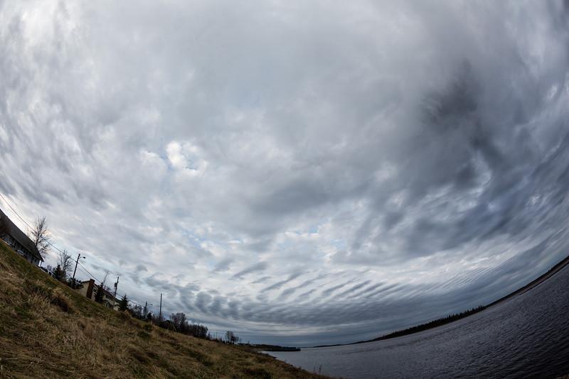 Long clouds over the Moose River at Moosonee.