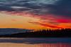 Sky before sunrise over Butler Island. Canoe on the river.