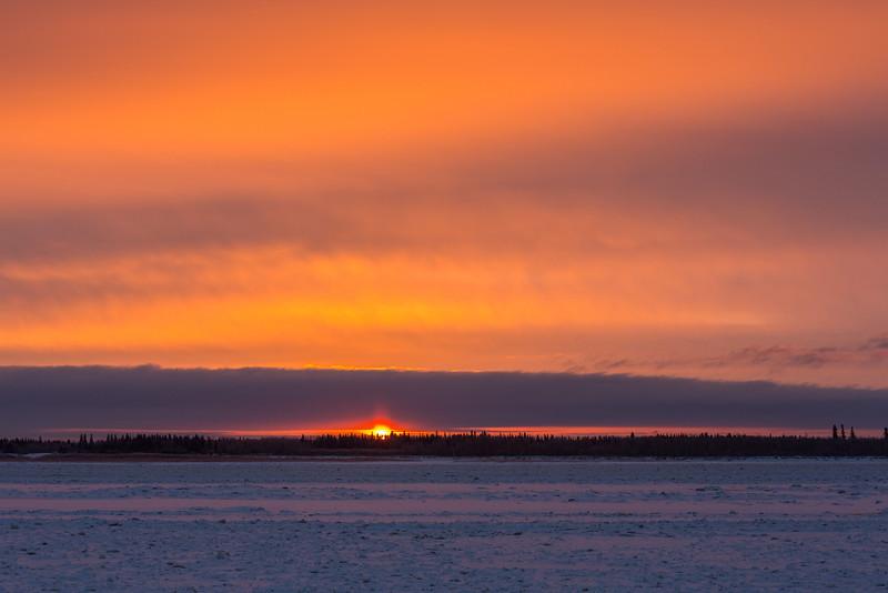 Sunrise at Moosonee, looking across the Moose River.