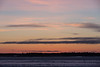 Sky across the Moose River from Moosonee before sunrise looking across the ice of the Moose River.