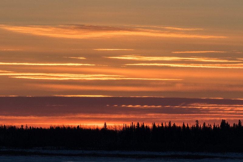 Looking across the Moose River from Moosonee around sunset.
