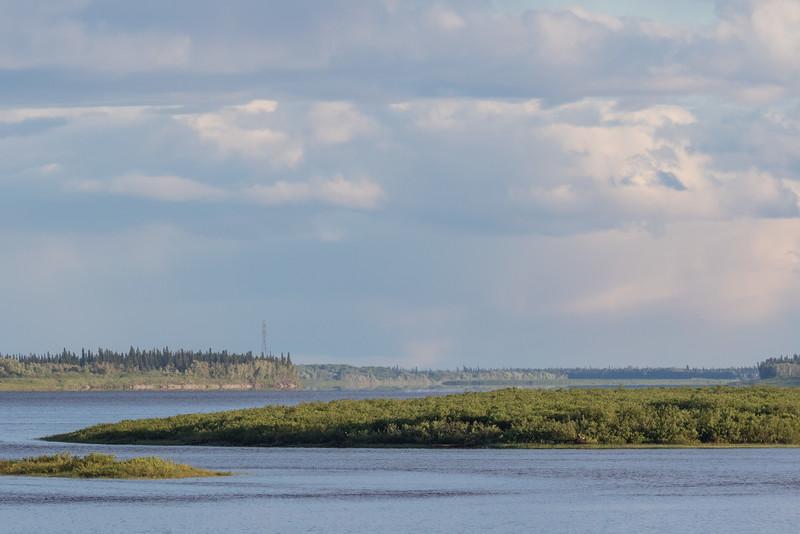 Looking up the Moose River from Moosonee under cloudy skies.