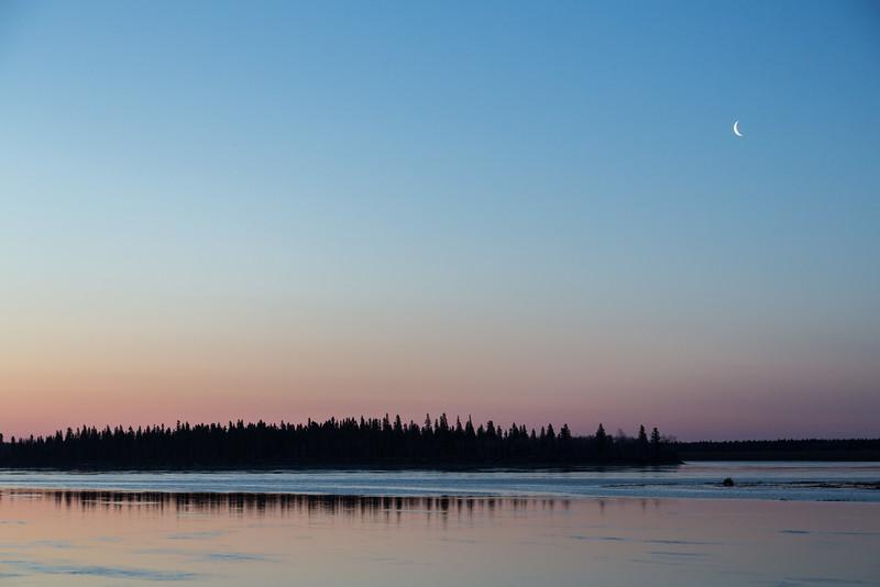 Moon in the morning sky over Butler Island before sunrise.