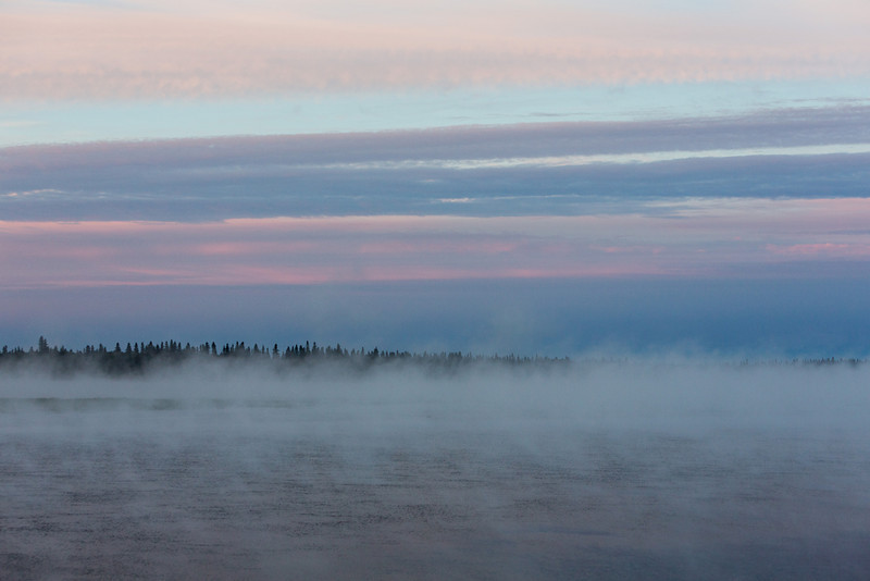 Across the Moose River on a foggy morning before sunrise.