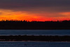Red and yellow sky across the Moose River before sunrise.