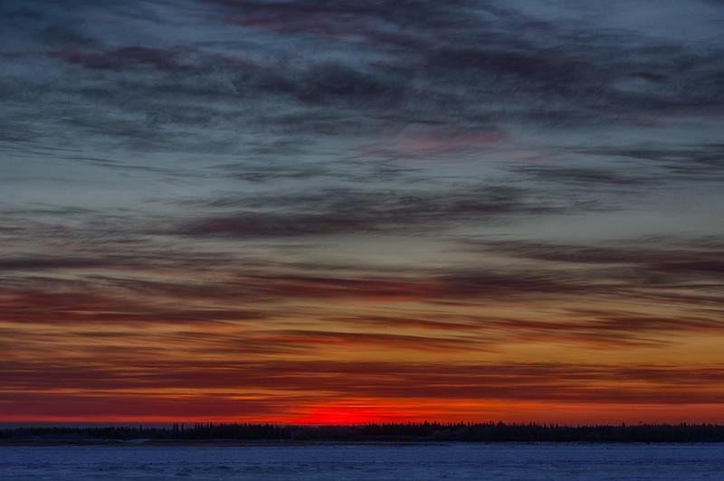 Colour in the sky across the frozen Moose River from Moosonee before sunrise. HDR Efx dark.