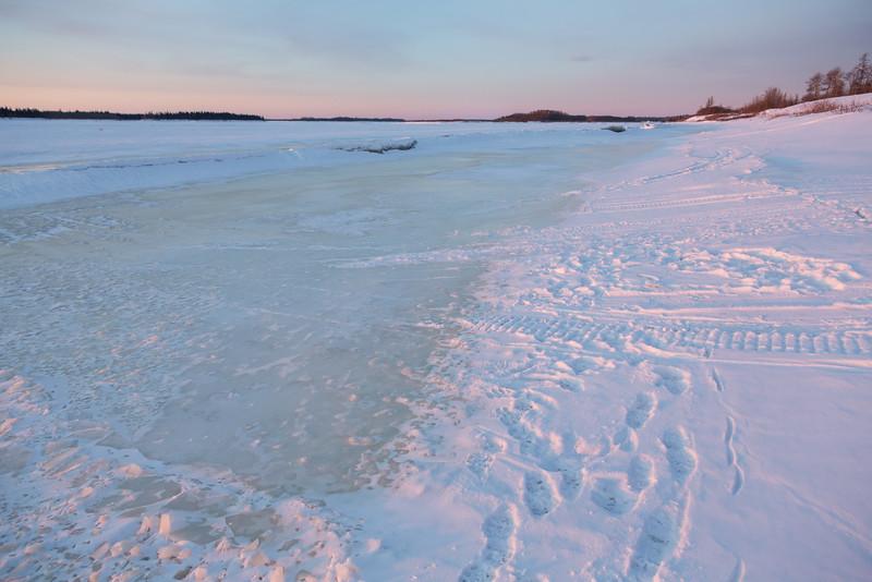 Moose River shoreline looking up river after sunrise.
