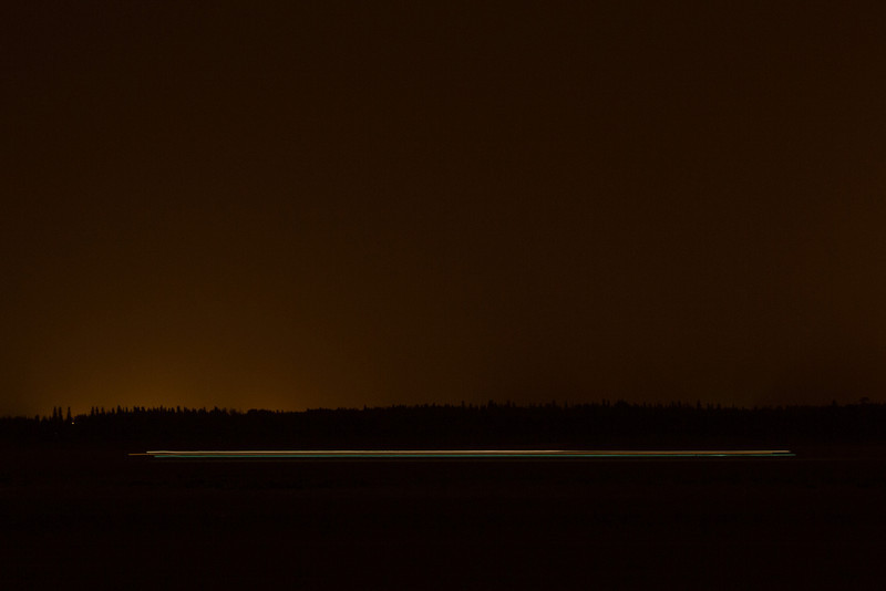 Lights from a boat heading to Moose Factory at night.