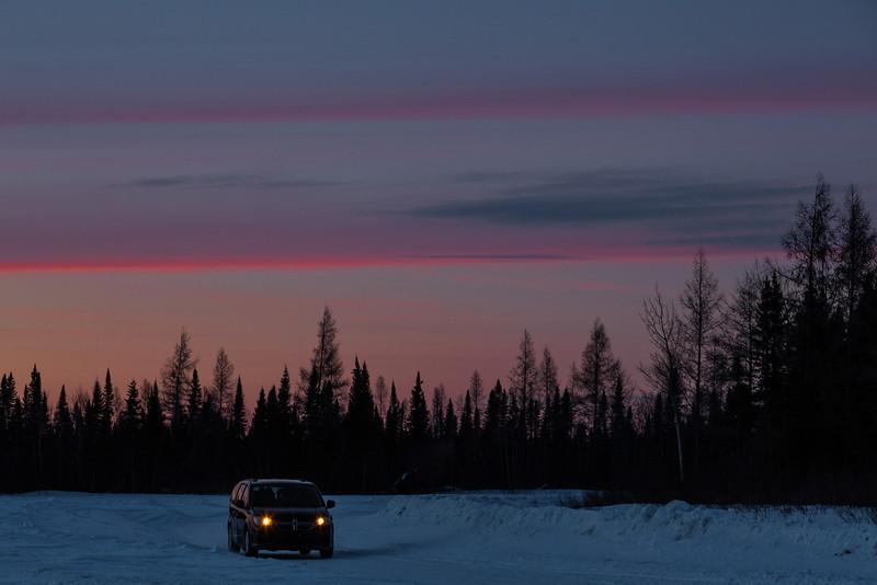 Sunset at Moosonee. Truck arriving in Moosonee on the winter road.