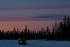 Sunset at Moosonee. Truck arriving in Moosonee on the winter road.