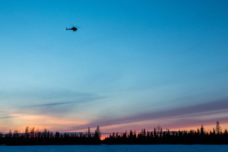 Sunset at Moosonee. Helicopeter.