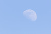 Faint moon in the afternoon sky.