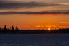 Sun climbing into view over Moose Factory Island. View from Moosonee, Butler Island at left.