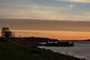 Barge docks in Moosonee at sunrise.