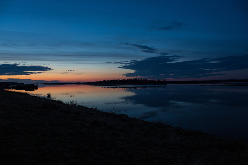 Looking down the Moose River before sunrise at Moosonee. Moon over Butler Island and its reflection in the Moose River.