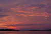 Clouds above the Moose River before sunrise at Moosonee. Two birds in sky at left.o
