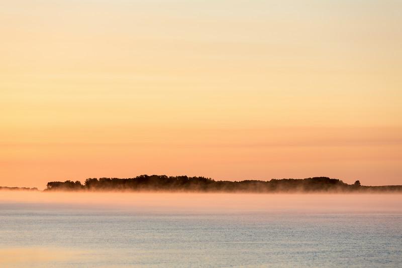 Fog across the Moose River at sunrise at Moosonee.