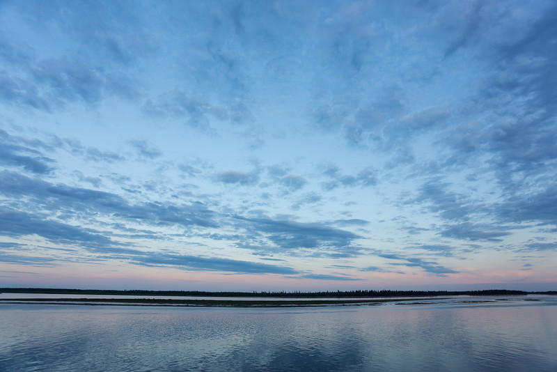 Clouds over the Moose River around sunset.