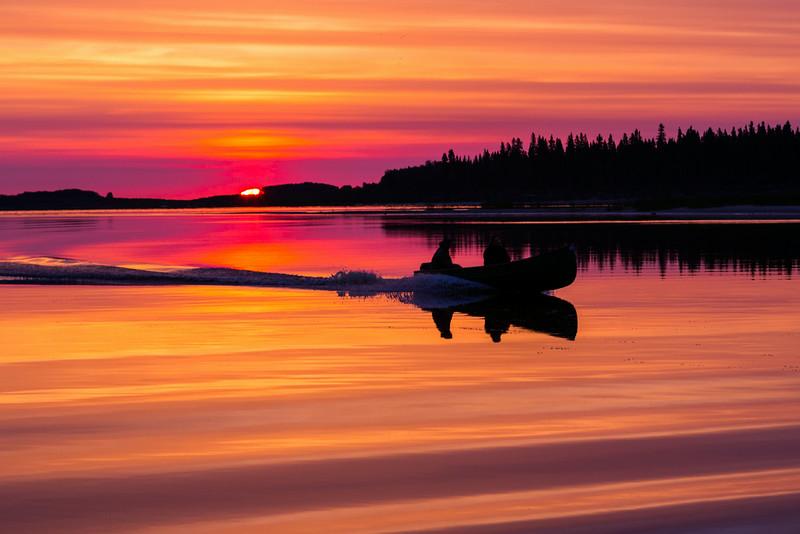 Canoe at sunrise on the Moose River at Moosonee.