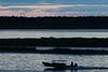 Canoe in silhouette, heading to Moose Factory from Moosonee.