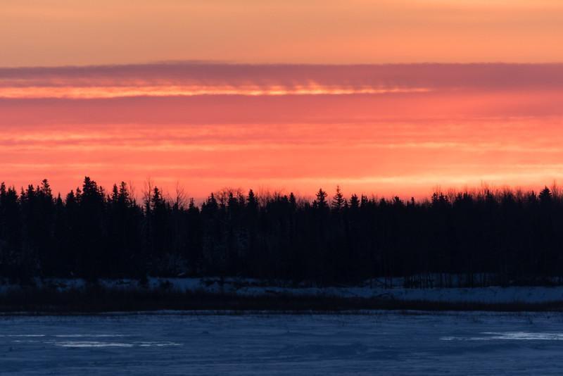 Looking across the Moose River from Moosonee shortly before sunrise.