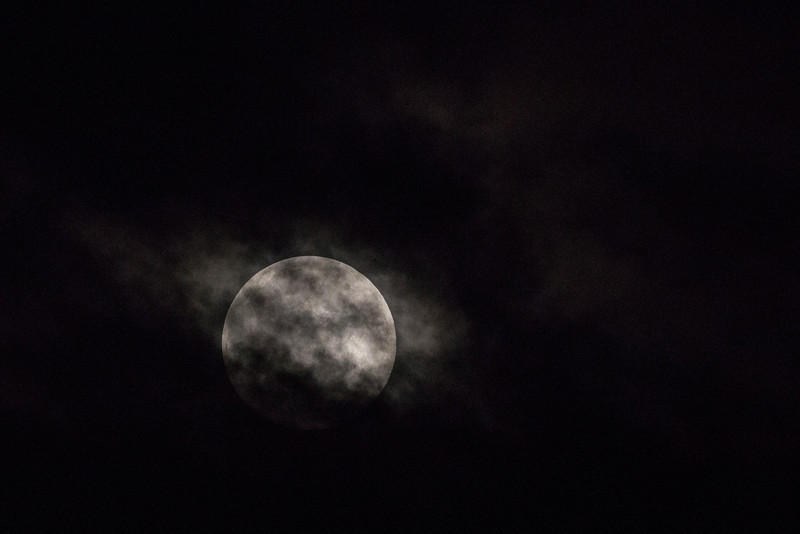Full moon over Moosonee through the clouds (blue moon).
