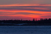 Looking across the Moose River from Moosonee, Ontario before sunrise. Pink clouds above the islands.