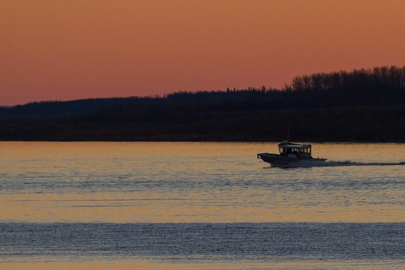 Boat heading to Moosonee before sunrise.