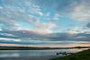 Clouds over the Moose River before sunset.