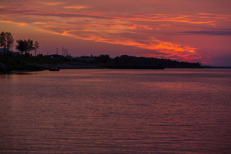 Clouds above the Moose River before sunrise at Moosonee.
