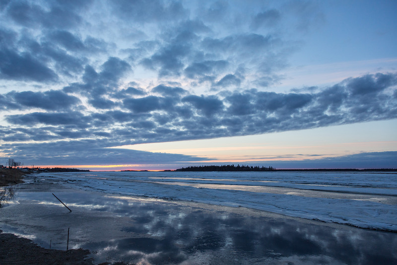 Moosonee. View down the Moose River after sunrise. Butler Island in the distance.
