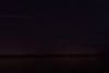 Looking across the Moose River at night. Possible white line is International Space Station.