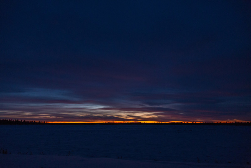 Sky before sunrise morning looking across the Moose River from Moosonee.