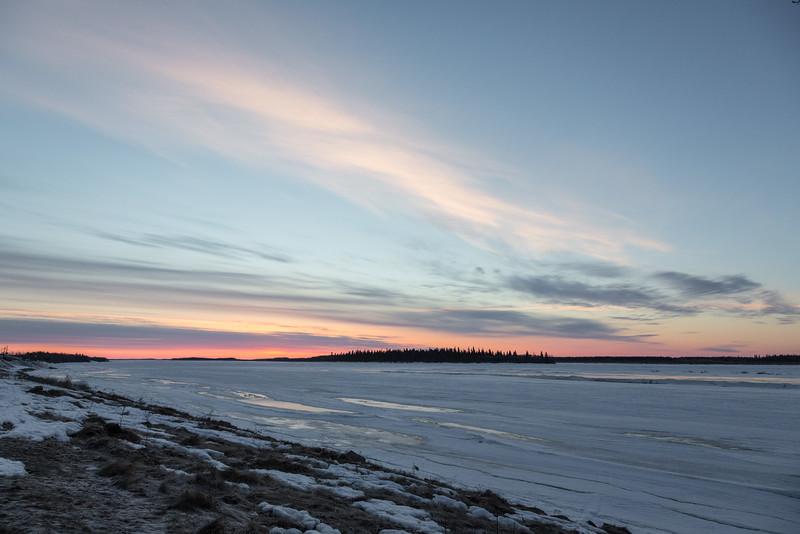 Wide view looking down the Moose River from Moosonee before sunrise.