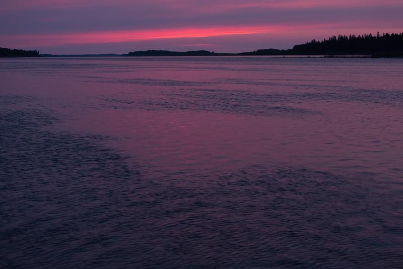 Sky before sunrise in Moosonee, looking down the Moose River. Cloudy.