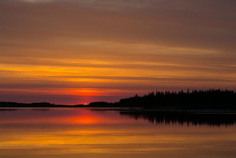 Sunrise over the Moose River at Moosonee.