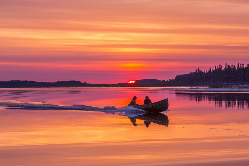 Canoe at sunrise on the Moose River at Moosonee. Shadows brightened.
