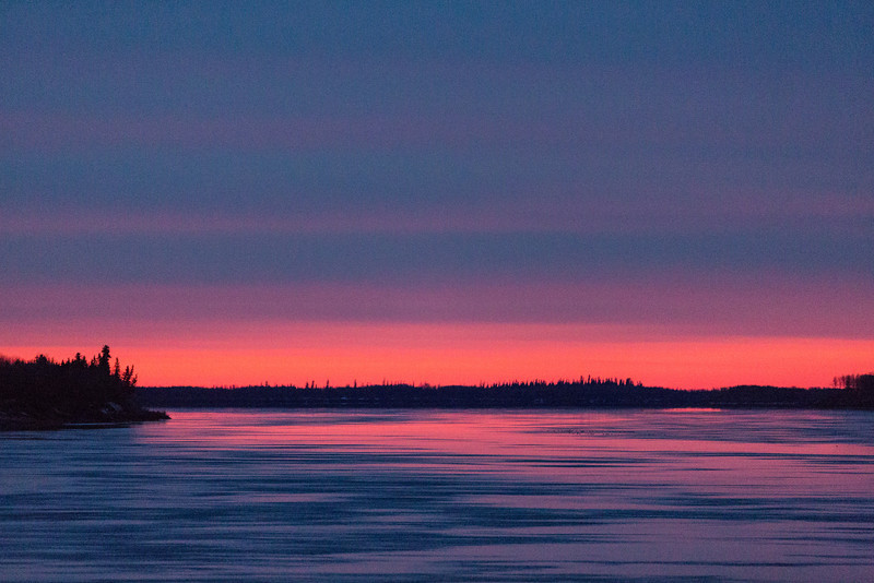 Looking down the Moose River from Moosonee before sunrise. Clouds over thin streak of colour.