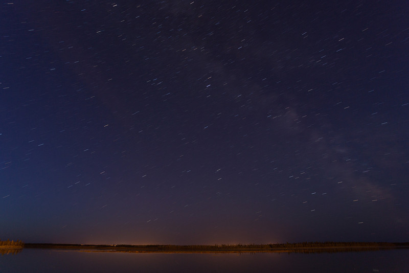 Night time looking across the Moose River. Stars show up as short lines in four minute exposure.