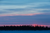 Sunrise over Butler Island in the Moose River across from Moosonee, Ontario.