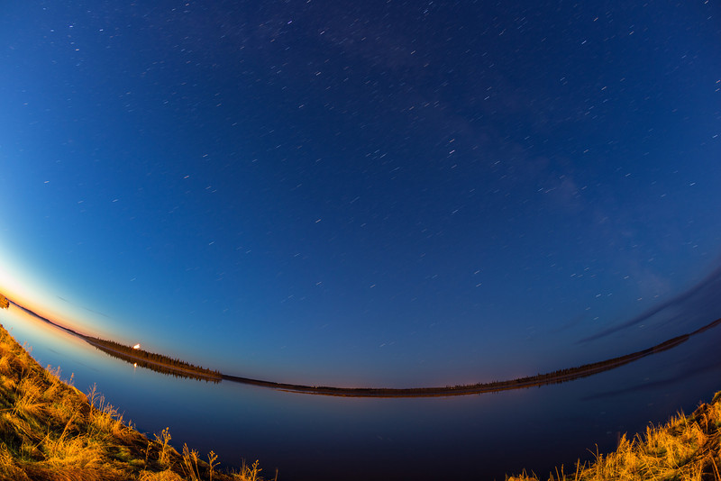Night time looking across the Moose River. Stars show up as lines in four minute exposure. Moon rising over Butler Island in lower left.