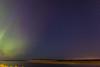 Aurora borealis over the Moose River at Moosonee. Meteor.