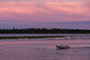 Taxi boat on the Moose River at Moosonee, Ontario before sunset. Charles Island in the background.
